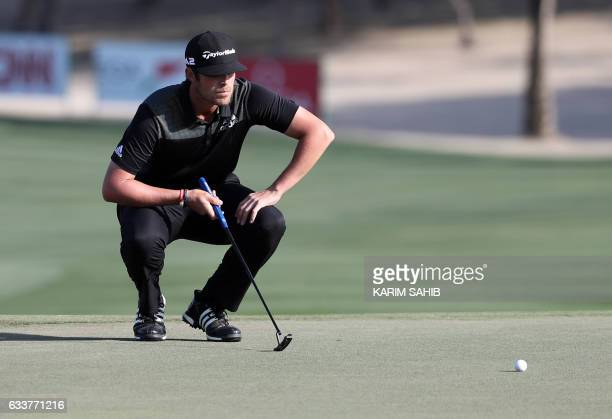 Nacho Elvira of Spain measures a shot during the third round of the Omega Dubai Desert Classic at the Emirates Golf Club on February 4 2017 in Dubai...