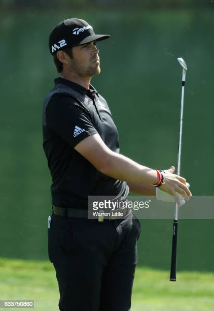 Nacho Elvira of Spain plays his second shot into the ninth green during the completion of the weather delayed second round of the Omega Dubai Desert...