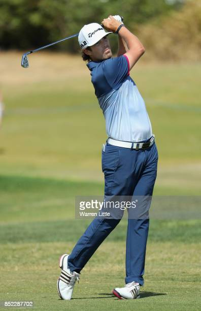 Nacho Elvira of Spain plays his second shot into the ninth green during the Portugal Masters at the Oceanico Victoria Golf Club on September 23 2017...