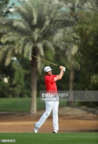 Nacho Elvira of Spain plays his second shot into the third green during the first round of the Omega Dubai Desert Classic at Emirates Golf Club on...