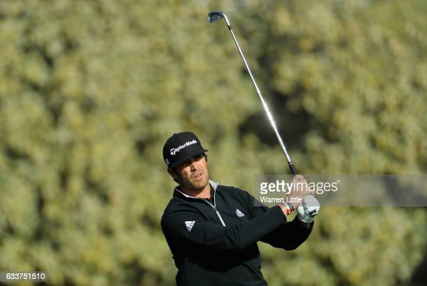 Nacho Elvira of Spain plays his second shot into the third green during the completion of the weather delayed second round of the Omega Dubai Desert...
