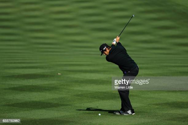 Nacho Elvira of Spain plays his third shot into the third green during the completion of the weather delayed second round of the Omega Dubai Desert...