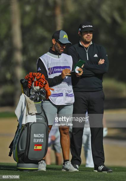 Nacho Elvira of Spain prepares to play his second shot into the third green during the completion of the weather delayed second round of the Omega...