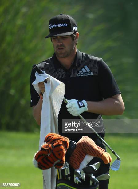 Nacho Elvira of Spain prepares to play his second shot on the ninth hole during the completion of the weather delayed second round of the Omega Dubai...