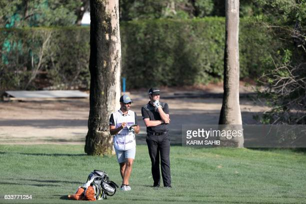 Nacho Elvira of Spain speaks to his caddie during the third round of the Omega Dubai Desert Classic at the Emirates Golf Club on February 4 2017 in...