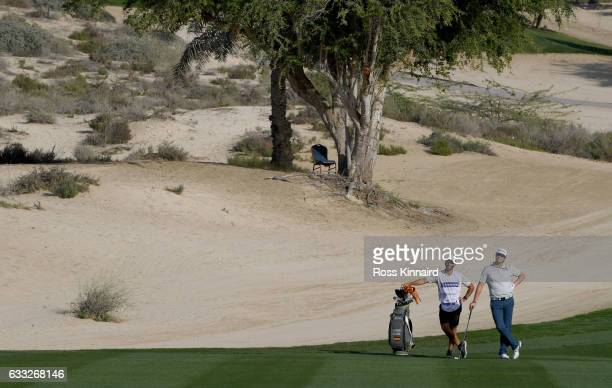 Nacho Elvira of Spain walking down the side of the 8th hole during the proam event prior to the Omega Dubai Desert Classic at Emirates Golf Club on...