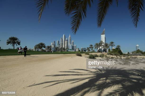 Nacho Elvira of Spain walks up the eight hole during the completion of the weather delayed second round of the Omega Dubai Desert Classic on the...