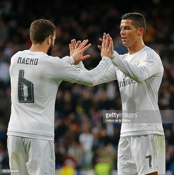 Nacho Fernandez and Cristiano Ronaldo of Real Madrid celebrate after scoring during the La Liga match between Real Madrid CF and Real Sociedad at...