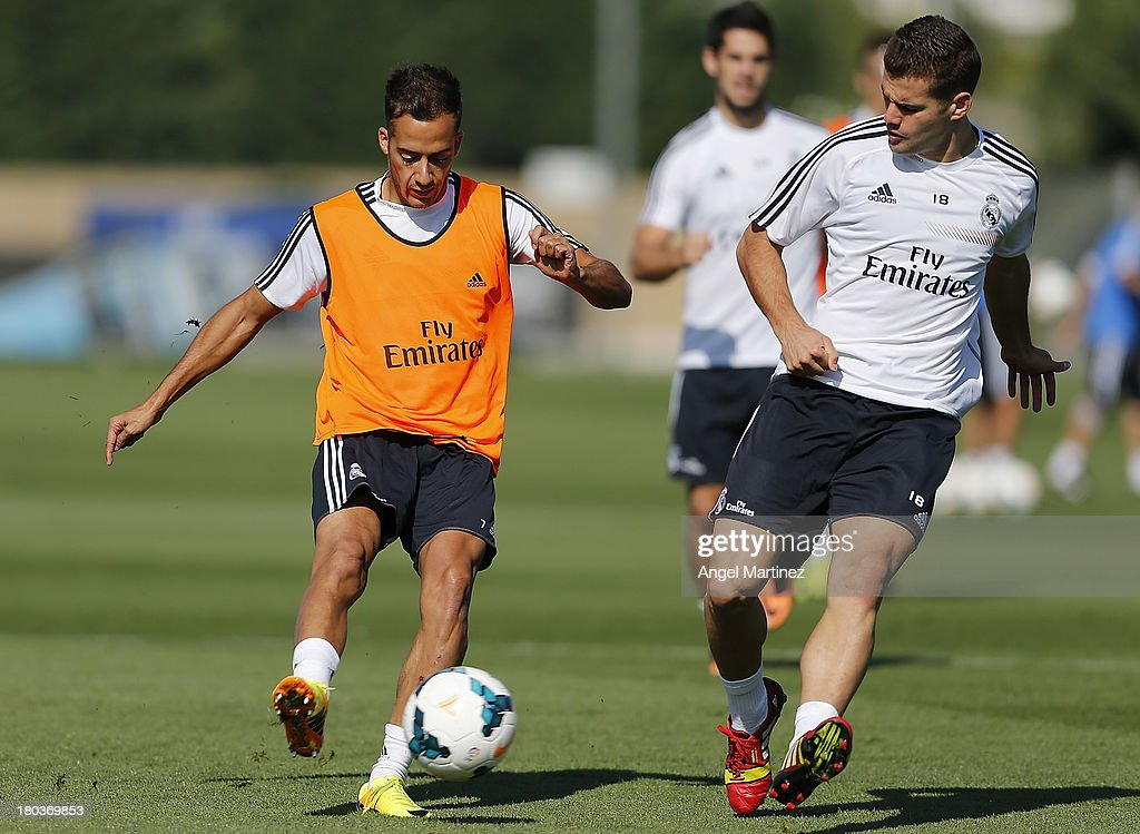 Nacho Fernandez (R) and Lucas Vazquez of Real Madrid in action during a training session at Valdebebas training ground on September 12, 2013 in Madrid, Spain.