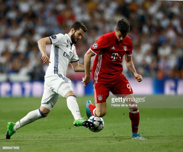 Nacho Fernandez of Real Madrid and Robert Lewandowski of FC Bayern Muenchen compete for the ball during the UEFA Champions League Quarter Final...