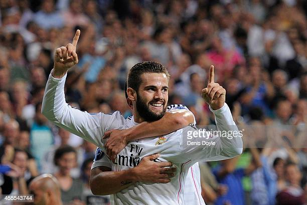 Nacho Fernandez of Real Madrid celebrates after scoring Real's opening goal during the UEFA Champions League Group B match between Real Madrid CF and...