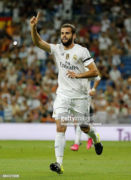 Nacho Fernandez of Real Madrid celebrates after scoring the opening goal during the Santiago Bernabeu Trophy match between Real Madrid and...