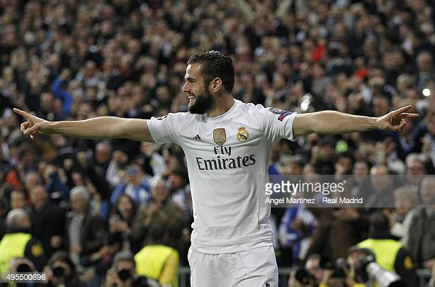 Nacho Fernandez of Real Madrid celebrates after scoring the opening goal during the UEFA Champions League Group A match between Real Madrid and Paris...