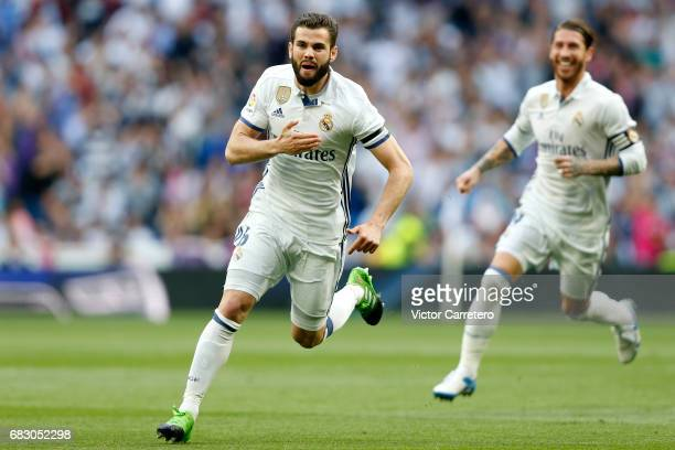 Nacho Fernandez of Real Madrid celebrates after scoring the opening goal during the La Liga match between Real Madrid and Sevilla FC at Estadio...