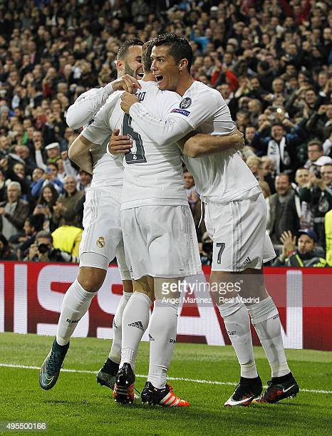 Nacho Fernandez of Real Madrid celebrates with Cristiano Ronaldo and Jese Rodriguez after scoring the opening goal during the UEFA Champions League...