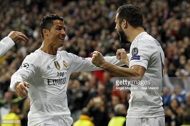 Nacho Fernandez of Real Madrid celebrates with Cristiano Ronaldo after scoring the opening goal during the UEFA Champions League Group A match...