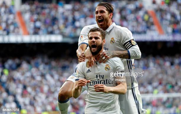 Nacho Fernandez of Real Madrid celebrates with his teammates Sergio Ramos and Danilo after scoring the opening goal during the La Liga match between...