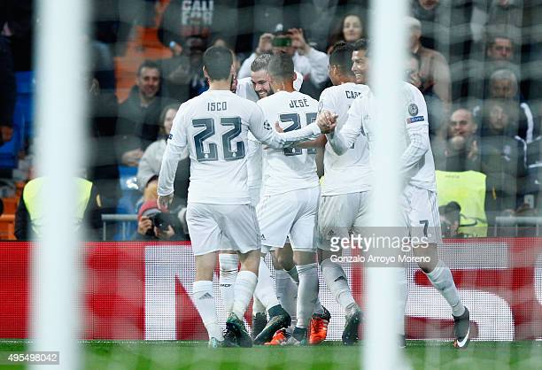 Nacho Fernandez of Real Madrid celebrates with team mates as he scores their first goal during the UEFA Champions League Group A match between Real...