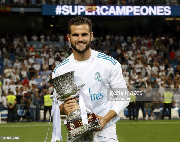 Nacho Fernandez of Real Madrid celebrates with the trophy after the Supercopa de Espana Final second leg match between Real Madrid and FC Barcelona...