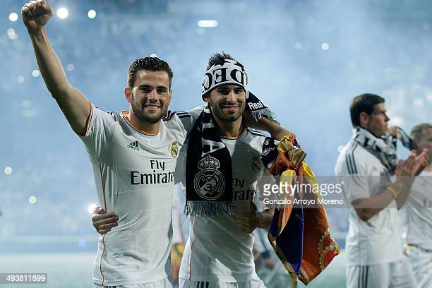 Nacho Fernandez of Real Madrid CF and teammate Jese Rodriguez are shown after the Real Madrid celebration the day after winning the UEFA Champions...