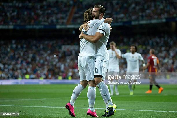 Nacho Fernandez of Real Madrid CF celebrates scoring their opening goal with teammate Luka Modric during the Santiago Bernabeu Trophy match between...