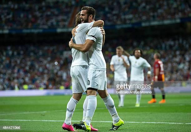 Nacho Fernandez of Real Madrid CF celebrates scoring their opening goal with teammate Luka Modric during the Santiago Bernabeu Trophy match between...