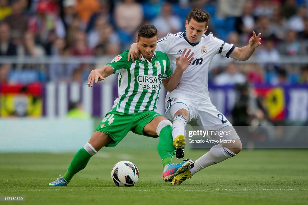 Nacho Fernandez of Real Madrid CF competes for the ball with Ruben Castro of Real Betis Balompie during the La Liga match between Real Madrid CF and...