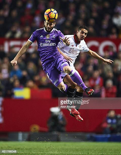 Nacho Fernandez of Real Madrid CF competes for the ball with Wissam Ben Yedder of Sevilla FC during the La Liga match between Sevilla FC and Real...