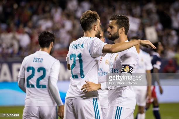 Nacho Fernandez of Real Madrid comes over to congratulate Borja Mayoral of Real Madrid for his goal during the MLS AllStar match between the MLS...