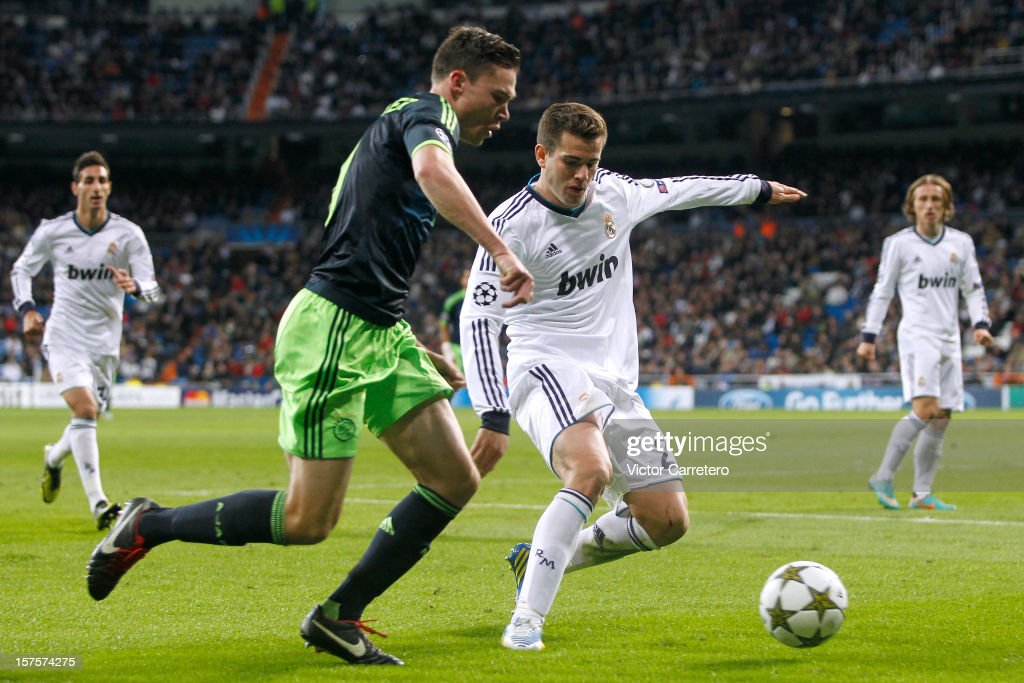 Nacho Fernandez of Real Madrid duels for the ball with <a gi-track='captionPersonalityLinkClicked' href=/galleries/search?phrase=Derk+Boerrigter&family=editorial&specificpeople=8003354 ng-click='$event.stopPropagation()'>Derk Boerrigter</a> of Ajax during the UEFA Champions League Group D match between Real Madrid and Ajax Amsterdam at Estadio Santiago Bernabeu on December 4, 2012 in Madrid, Spain.