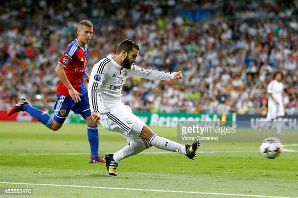 Nacho Fernandez of Real Madrid scores the opening goal during the UEFA Champions League group B match between Real Madrid and FC Basel 1893 at...