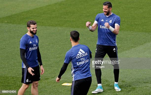 Nacho Fernández of Real Madrid Marco Asensio of Real Madrid and Kiko Casilla of Real Madrid warms up during a training session at Valdebebas training...