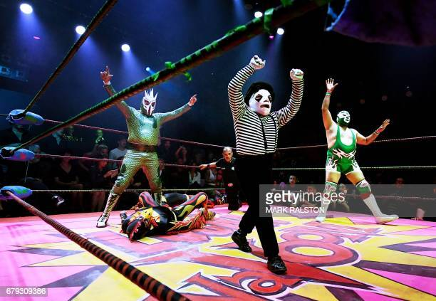 TOPSHOT Nacho Libre wrestler Li'l Mime who is dressed as a Frenchman performs during a special Cinco de Mayo show by the Lucha Vavoom ensemble in Los...
