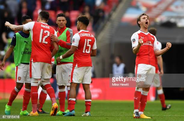 Nacho Monreal and Arsenal players celebrate their 21 victory in the Emirates FA Cup SemiFinal match between Arsenal and Manchester City at Wembley...