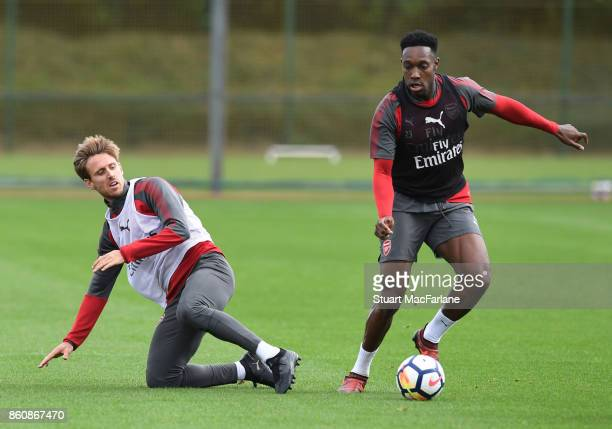 Nacho Monreal and Danny Welbeck of Arsenal during a training session at London Colney on October 13 2017 in St Albans England