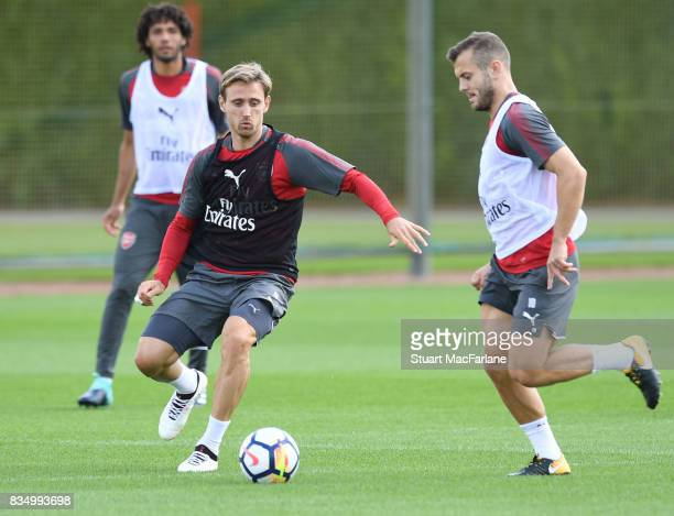 Nacho Monreal and Jack Wilshere of Arsenal during a training session at London Colney on August 18 2017 in St Albans England