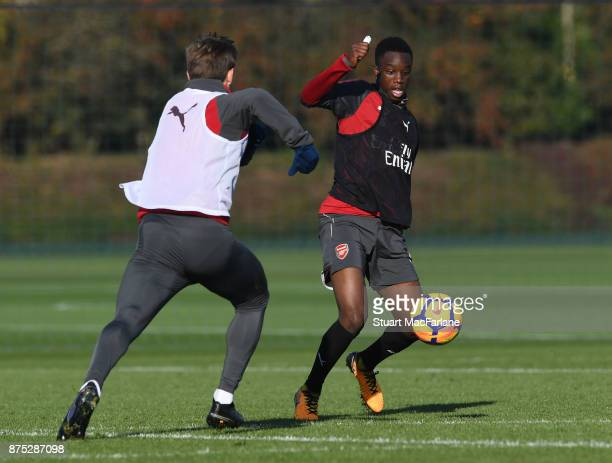 Nacho Monreal and James Olayinka of Arsenal during a training session at London Colney on November 17 2017 in St Albans England