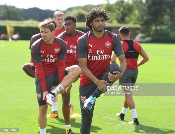 Nacho Monreal and Mohamed Elneny of Arsenal during a training session at London Colney on August 18 2017 in St Albans England