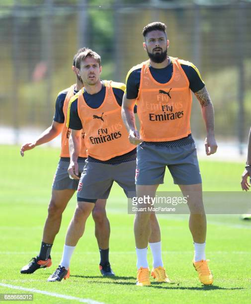 Nacho Monreal and Olivier Giroud of Arsenal during a training session at London Colney on May 26 2017 in St Albans England