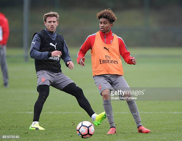 Nacho Monreal and Reiss Nelson of Arsenal during a training session at London Colney on January 6 2017 in St Albans England
