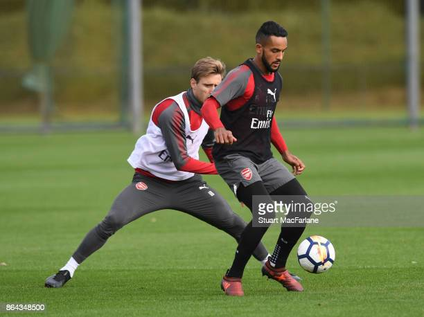 Nacho Monreal and Theo Walcott of Arsenal during a training session at London Colney on October 21 2017 in St Albans England