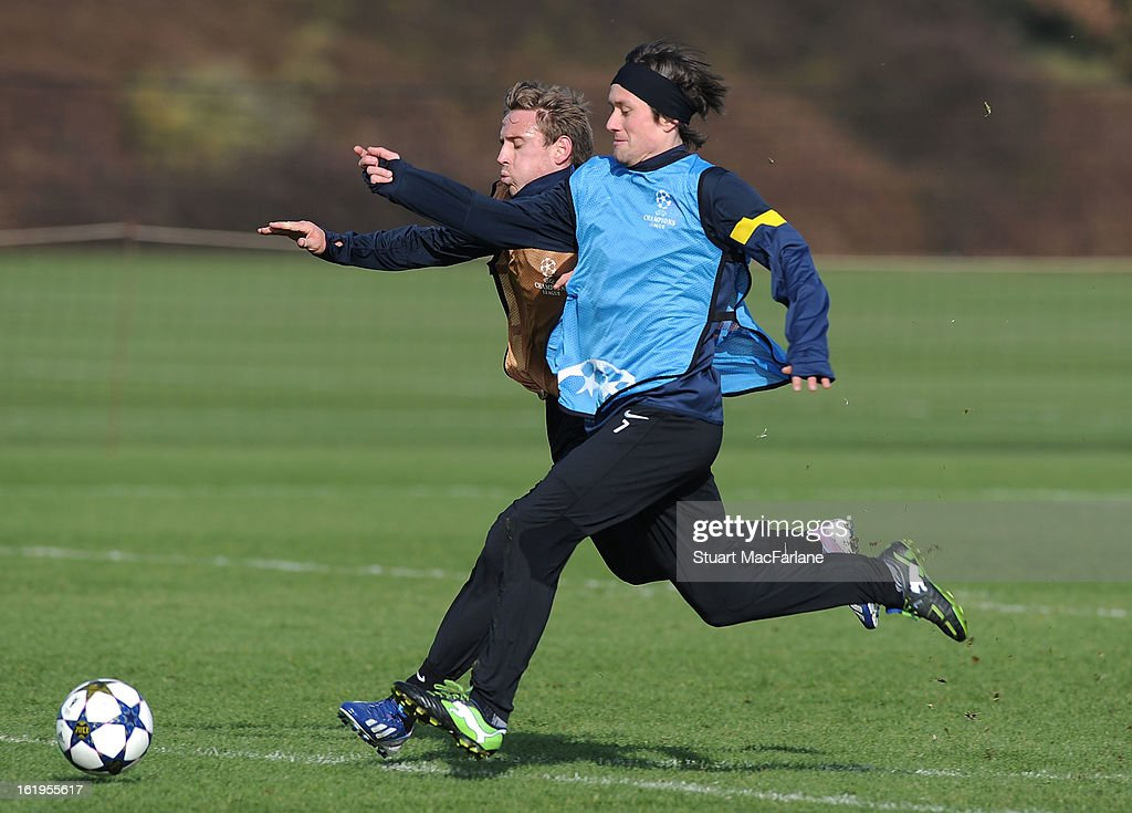 Nacho Monreal and Tomas Rosicky (R) of Arsenal in action during a training session ahead of their UEFA Champions League match against FC Bayern Muenchen at London Colney on February 18, 2013 in St Albans, England.