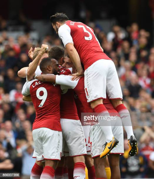 Nacho Monreal celebrates scoring a goal for Arsenal with Sead Kolasinac during the Premier League match between Arsenal and Brighton and Hove Albion...