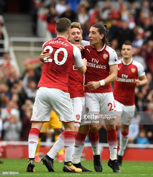 Nacho Monreal celebrates scoring a goal for Arsenal with Shkodran Mustafi and Hector Bellerin during the Premier League match between Arsenal and...