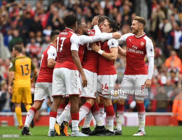 Nacho Monreal celebrates scoring a goal for Arsenal with Shkodran Mustafi Alexandre Lacazette Aaron Ramsey and Hector Bellerin during the Premier...