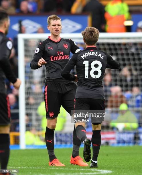Nacho Monreal celebrates scoring Arsenal's 1st goal with Per Mertesacker during the Premier League match between Everton and Arsenal at Goodison Park...