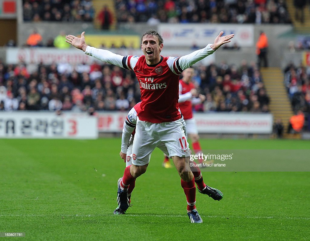 <a gi-track='captionPersonalityLinkClicked' href=/galleries/search?phrase=Nacho+Monreal&family=editorial&specificpeople=4078049 ng-click='$event.stopPropagation()'>Nacho Monreal</a> celebrates scoring the 1st Arsenal goal during the Premier League match between Swansea City and Arsenal at Liberty Stadium on March 16, 2013 in Swansea, Wales.