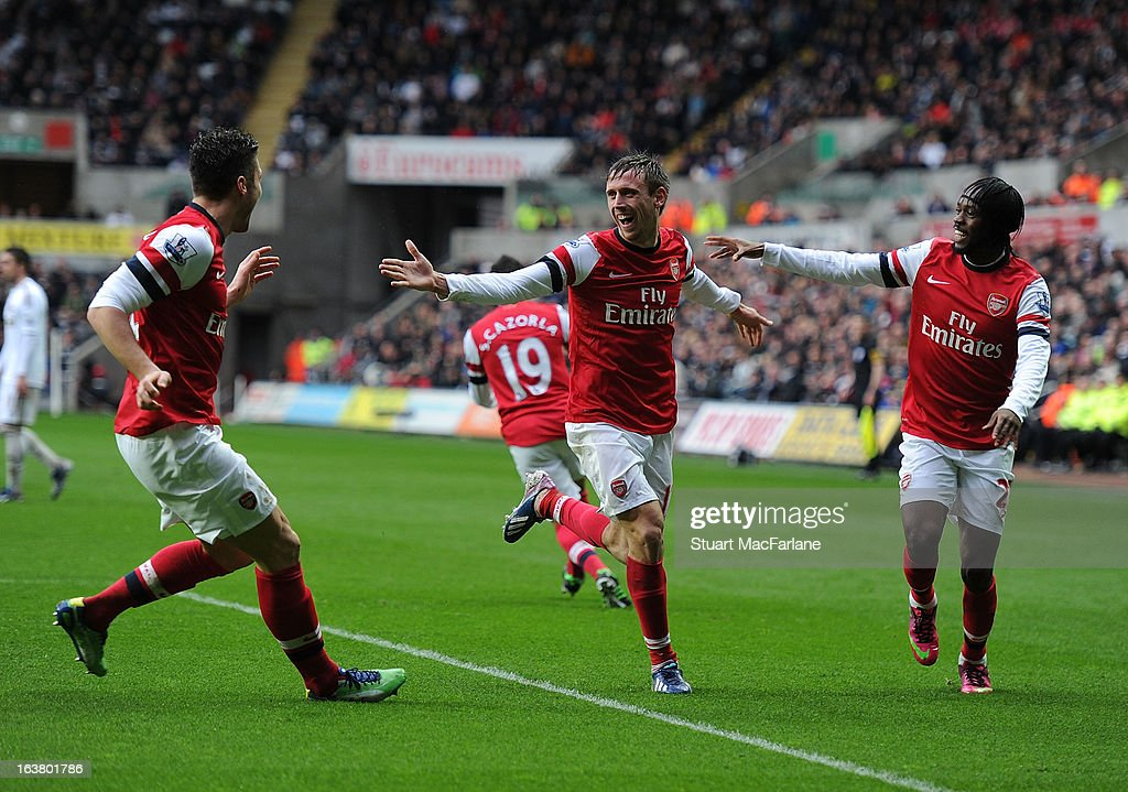 <a gi-track='captionPersonalityLinkClicked' href=/galleries/search?phrase=Nacho+Monreal&family=editorial&specificpeople=4078049 ng-click='$event.stopPropagation()'>Nacho Monreal</a> celebrates scoring the 1st Arsenal goal with (L) <a gi-track='captionPersonalityLinkClicked' href=/galleries/search?phrase=Olivier+Giroud&family=editorial&specificpeople=5678034 ng-click='$event.stopPropagation()'>Olivier Giroud</a> and (R) <a gi-track='captionPersonalityLinkClicked' href=/galleries/search?phrase=Gervinho&family=editorial&specificpeople=4500752 ng-click='$event.stopPropagation()'>Gervinho</a> during the Premier League match between Swansea City and Arsenal at Liberty Stadium on March 16, 2013 in Swansea, Wales.