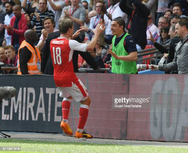 Nacho Monreal celebrates scoring the 1st Arsenal goal with substitute Hector Bellerin during the Emirates FA Cup SemiFinal match between Arsenal and...