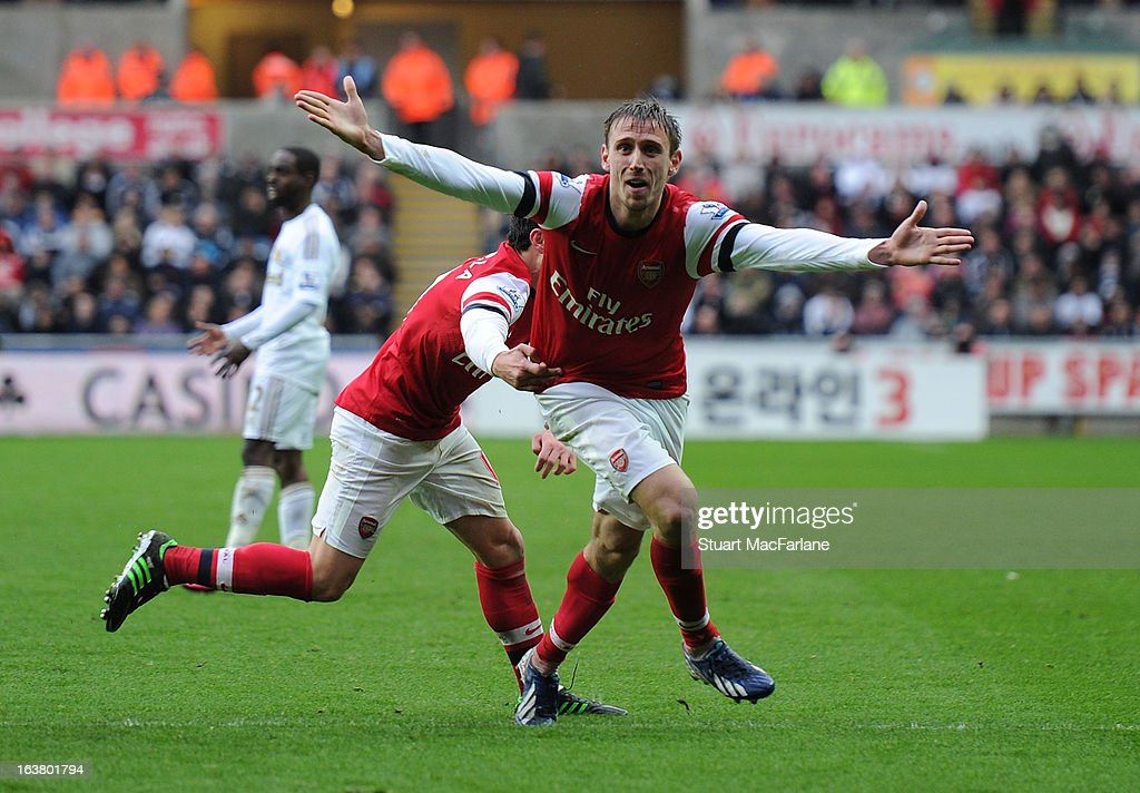 <a gi-track='captionPersonalityLinkClicked' href=/galleries/search?phrase=Nacho+Monreal&family=editorial&specificpeople=4078049 ng-click='$event.stopPropagation()'>Nacho Monreal</a> celebrates scoring the 1st Arsenal with Santi Cazorla goal during the Premier League match between Swansea City and Arsenal at Liberty Stadium on March 16, 2013 in Swansea, Wales.